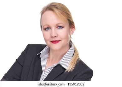 Close up portrait of a serious businesswoman isolated on white