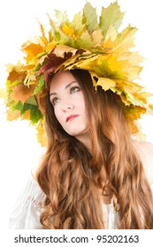 close up portrait of sexual woman with autumn wreath of maple leaves on the head on an isolated white background.