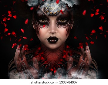 close up portrait of sexy witch with halloween makeup. red and black face painting. lush hairdo. flying petals