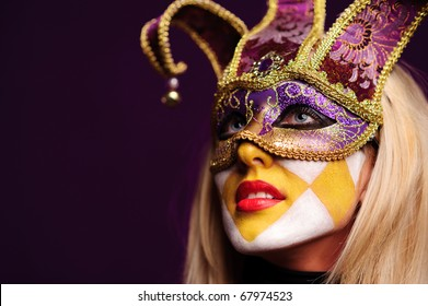 close up portrait of sexy woman in party mask isolated on violet background