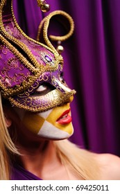 close up portrait of sexy woman in party mask