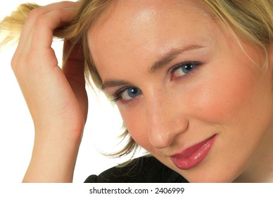 Close up portrait shot of blond girl playing with her hair