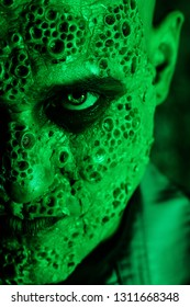 A close up portrait of a sick scientist after a failed experiment in the green light. desperation, hopelessness. Horror, halloween.