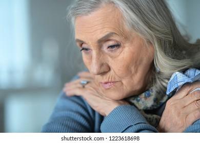 Close up portrait of sick senior woman