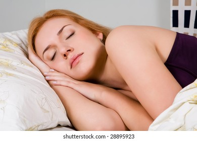 Close up portrait of sleeping lovely woman in bed