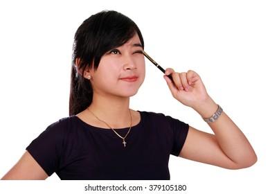 Close up portrait of smart Asian girl thinking, isolated on white background