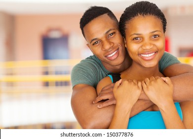 close up portrait of smiling afro american college couple