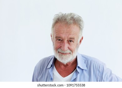 Close up portrait of a smiling attractive senior man looking directly at the camera with white background