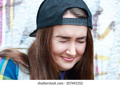 Close up portrait of smiling beautiful young woman with closed eyes