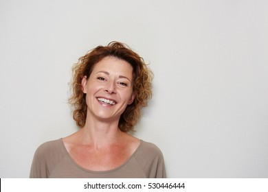 Close up portrait of smiling brunette woman on white background