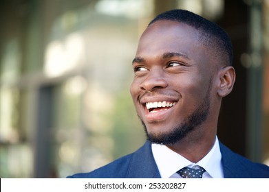Close up portrait of a smiling business man in the city