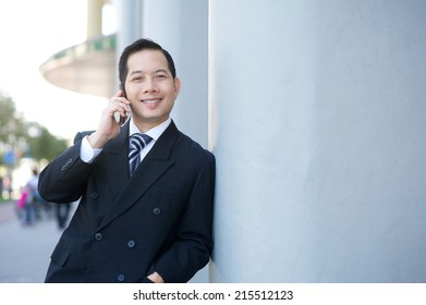 Close up portrait of a smiling businessman calling with cellphone