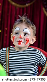 Close up Portrait of a Smiling Cute Male Kid with Mime Makeup for Stage Play