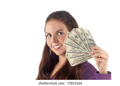 Close up portrait of smiling girl with dollar's banknotes pile isolated on white background