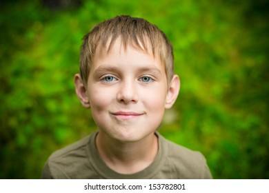 Close up portrait of smiling little boy outdoors