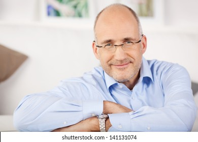 Close portrait of smiling man relaxing at home