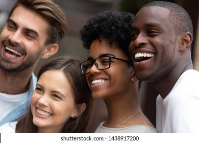 Close up portrait of smiling multiracial millennial friends laugh stand posing for group picture together, happy diverse young people feel overjoyed look at camera making selfie. Friendship concept