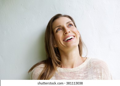 Close up portrait of a smiling older woman looking up