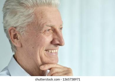 Close up portrait of smiling senior man posing