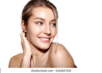 Close up portrait of smiling wonderful woman posing with bare shoulders. Cute girl with clean and fresh skin. Skincare wellness and spa concept. Isolated on white copy space in right side