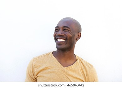 Close up portrait of smiling young african man against white background