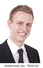 Close up portrait of a smiling young business man in black suit, isolated on white.