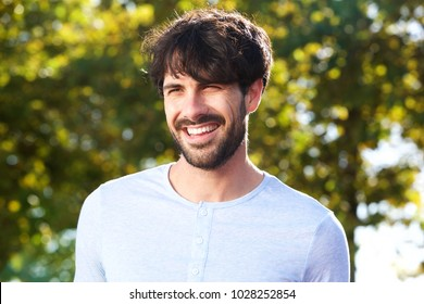Close up portrait of smiling young man outdoors