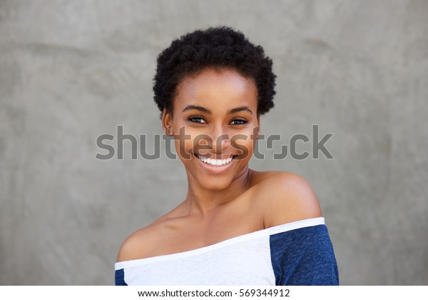 Close up portrait of smiling young modern black woman