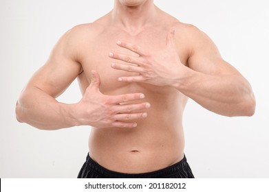 Close up portrait of strong masculine torso with hands