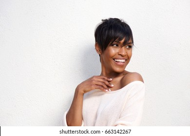 Close up portrait of stylish young black female model looking away against white background
