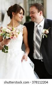 Close up portrait of stylish young newlyweds outdoors