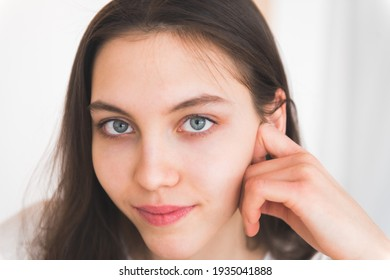 Close up portrait of teen girl blue eyes