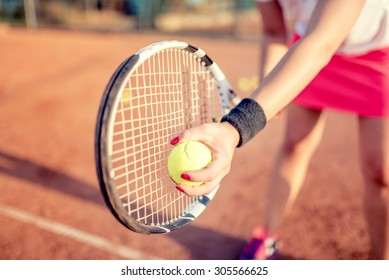 close up portrait of tennis racquet with fitness girl. healthy training for sportswoman details