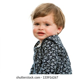 Close up portrait of toddler with confused face expression.Isolated.