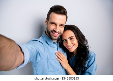 Close up portrait two amazing she her he him his couple lady guy couple make take selfies wife husband valentine day wear casual jeans denim shirts outfit clothes isolated light grey background