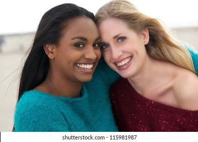 Close up portrait of two happy women smiling