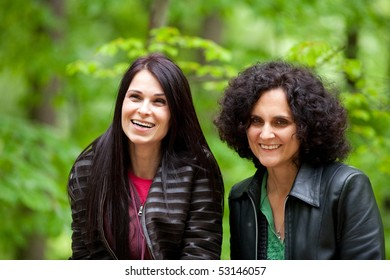 Close up portrait of two happy young ladies outdoor