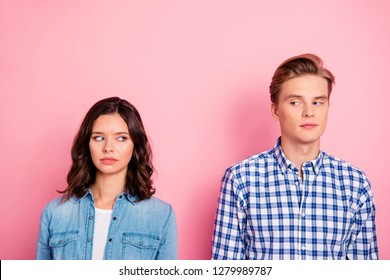 Close up portrait of two she her he him his best friends boy lady with offended look do not speak tell talk to each other wearing casual shirts denim plaid outfit isolated on rose background