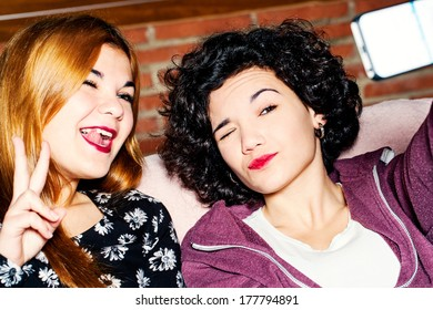 Close up portrait of two teen girls having fun with camera.