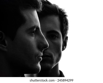 close up portrait two  young men in shadow white background