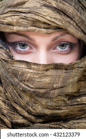 Close up portrait of veiled woman with beautiful blue eyes.