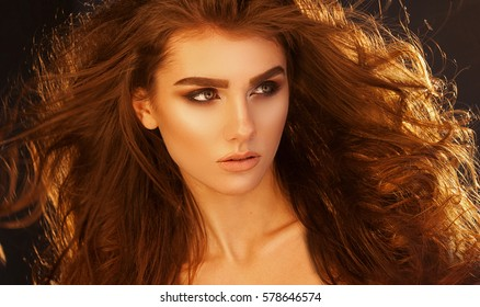 Close up portrait of very beautiful woman with volume healthy curly hair. Woman beauty concept.