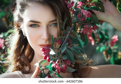 Close up portrait of very beautiful woman in string blossom flowers