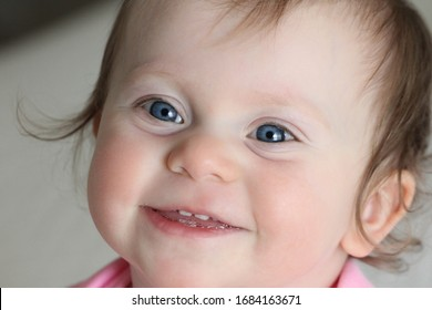 Close up Portrait, Very Cute and Beautiful 1 Years Old Baby Girl with big Blue Eyes, Smiling, Adorable Toddler Girl