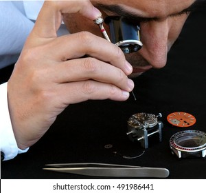 Close up portrait of a watchmaker repairing watch
