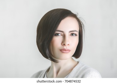 Close up portrait of white woman on gray background. Headshot concept