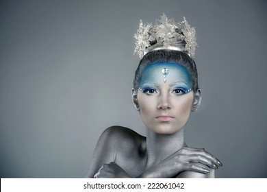 Close up portrait of a woman with creative make up and body painting as Ice Queen