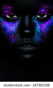 Close up portrait of a  woman face with neon make up