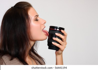 close up portrait of a woman licking objective