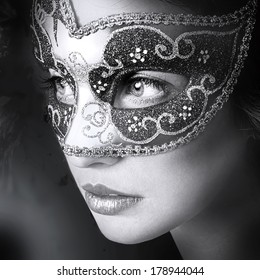 Close up portrait of woman in mysterious venetian mask